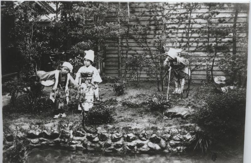 """Iwanaga's kindergarten students in a pose from Shita-kiri Suzume (""""Tongue-Cut Sparrow""""), Kumamoto, 1920s"""