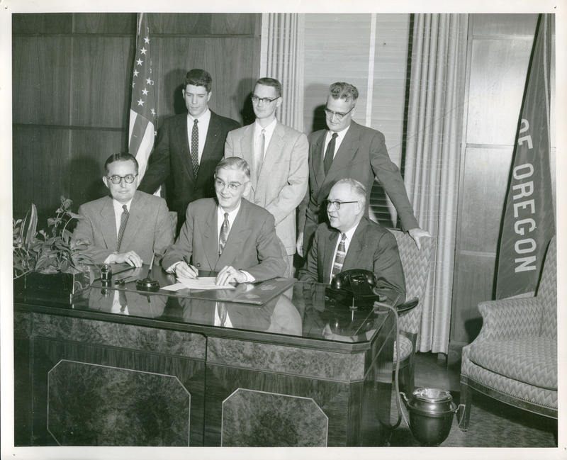 Signing the bill that would establish Portland State College