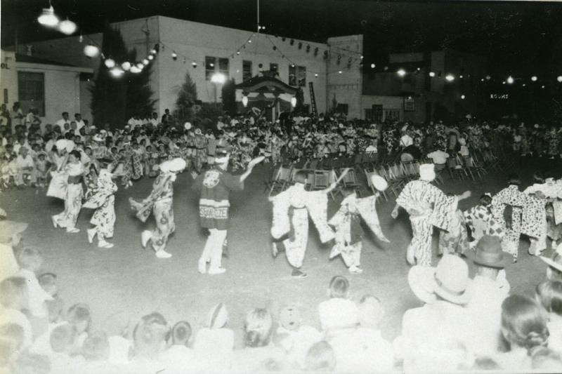 Bon odori with participants dancing counter-clockwise, Sacramento, 1930s